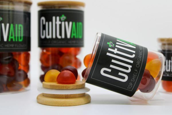Cultivaid gummies - open jar with gummies spilling out