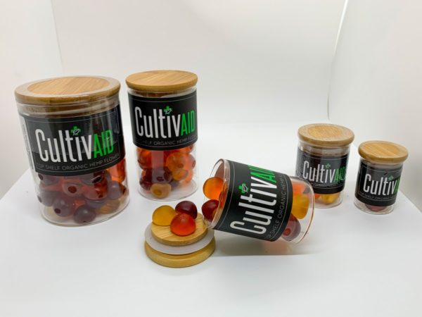 five jars of Cultivaid Hemp Gummies with gummies spilling out of one jar