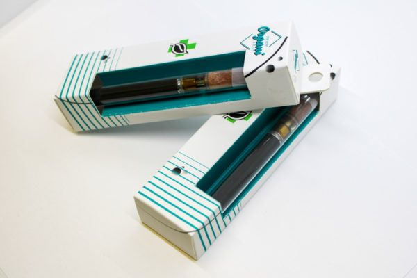 EV1 Disposable, Rechargeable Vape Pens with Wood Tips in packages